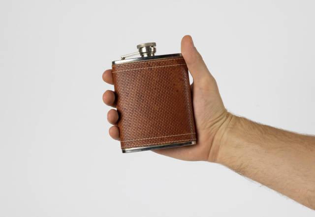 Man holding hip flask