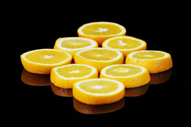 Fresh slices of orange fruit, black background