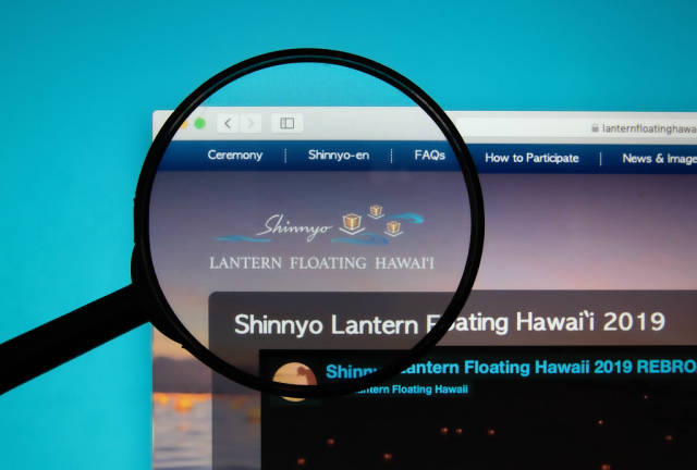 Lantern Floating Hawaii logo on a computer screen with a magnifying glass