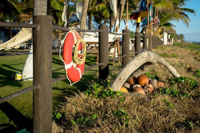 Orange lifesaver tied to wooden fence