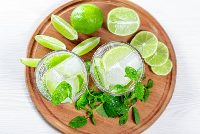 Top view of refreshing summer drink with mint and lime