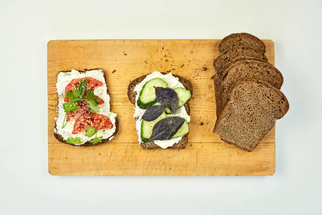 Fast snacks made with bread toasts, vegetables and herbs
