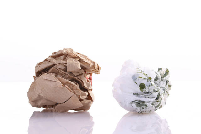 Crumpled paper and plastic bag on white background
