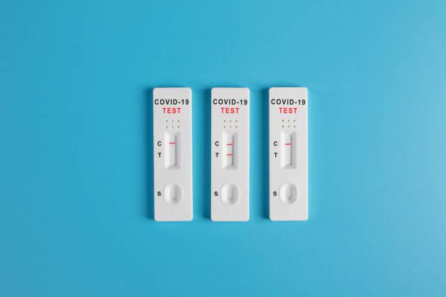 Covid-19 Antigen tests on blue background