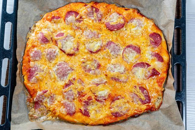 Hot homemade pizza on a baking sheet