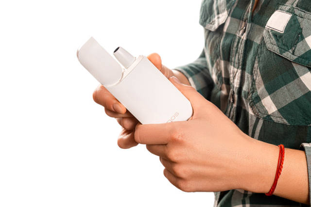 Modern innovative product for smokers in women hands