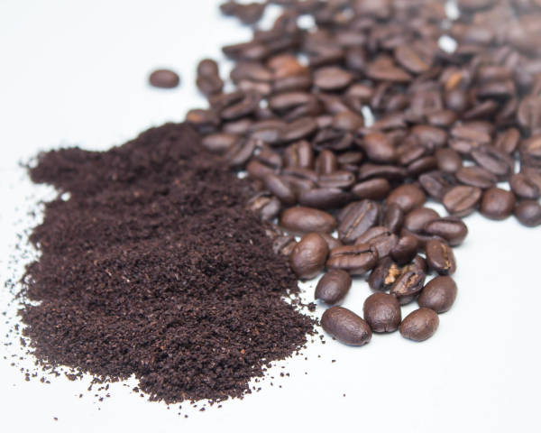 Ground Coffee and Bean on a White Background