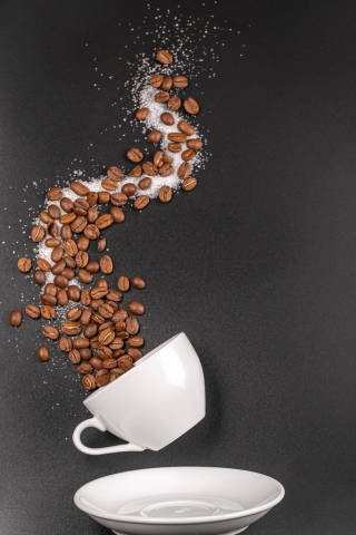 Beautiful coffee background with cup, saucer, sugar and coffee beans