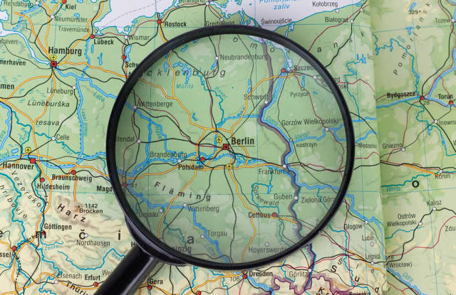 Berlin on map under a magnifying glass