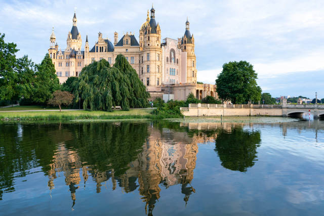 Farytail like picture of beautiful Schwerin castle reflecting in the lake