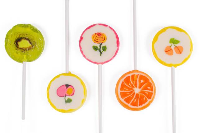 Sweet set of lollipops on white background