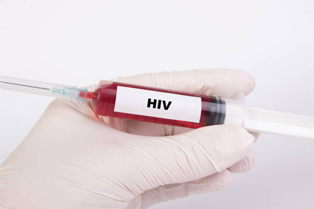 Injection needle with HIV text