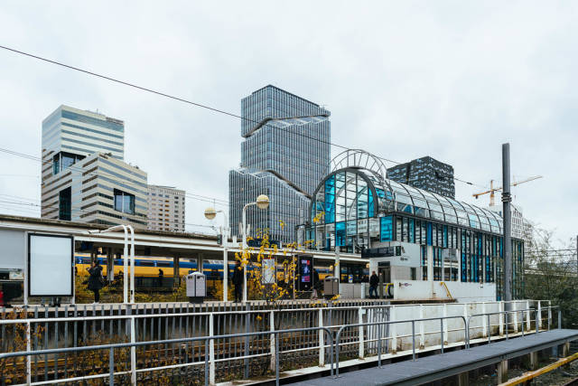 Amsterdam-Zuid train station with modern glass high-rise buildings in the background