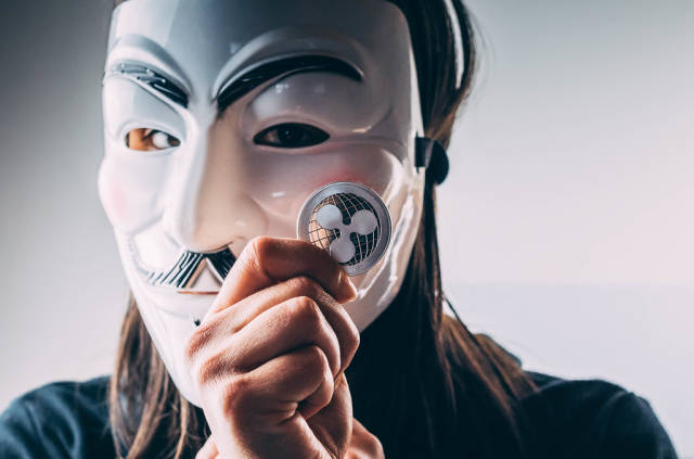 Girl with mask holding Ripple coin
