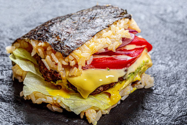 Fresh sushi Burger with vegetables close up