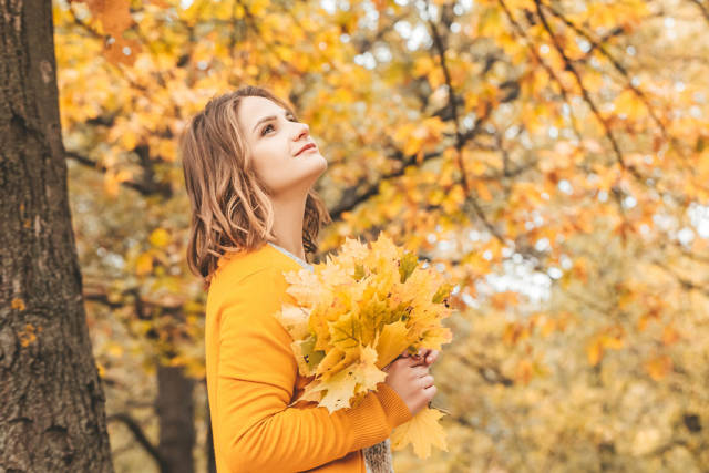 Colorful autumn background with girl and autumn landscape