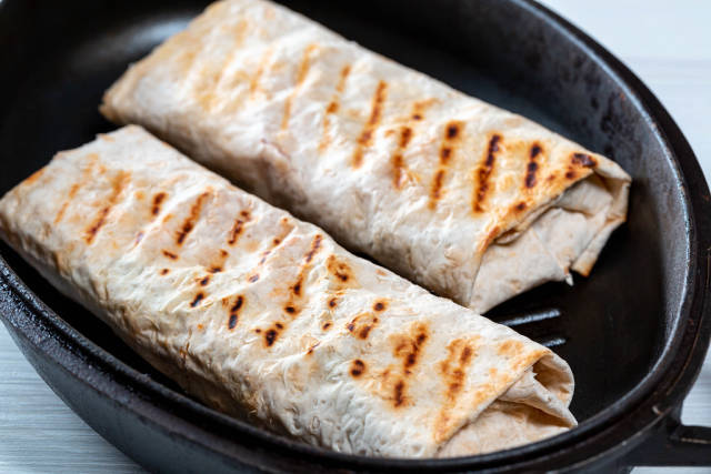 The pita bread with the filling in the pan
