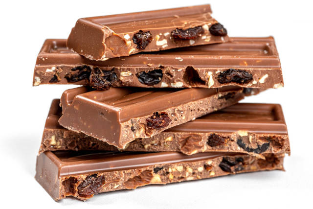 Slices of milk chocolate with nuts and raisins