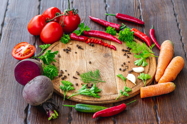 Vegetables and spices on a brown wooden background
