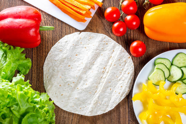 Fresh vegetables and round pita for cooking summer snacks