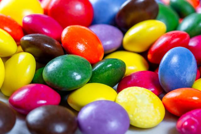 Chocolate small candies in multi-colored glaze
