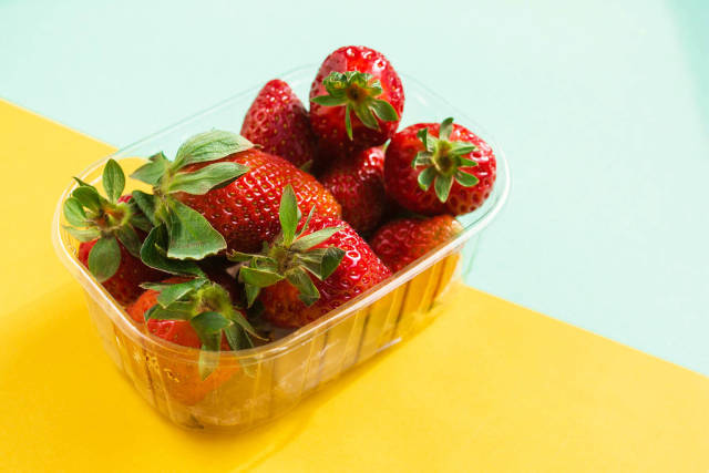 Fresh strawberries on colorful background