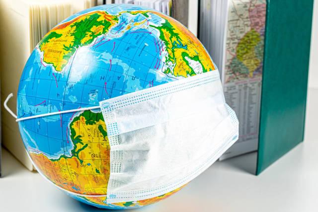 Globe in a medical mask. World danger concept