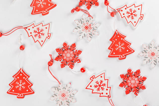 Red and white wooden Christmas decor on white background