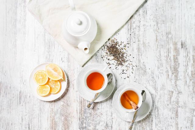 Cups of herbal tea and lemon slices