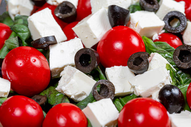 Salad with fresh tomatoes, Basil and feta cheese closeup