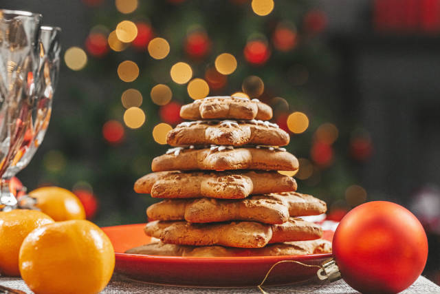 Stack of gingerbread in a red plate on a new years background bokeh