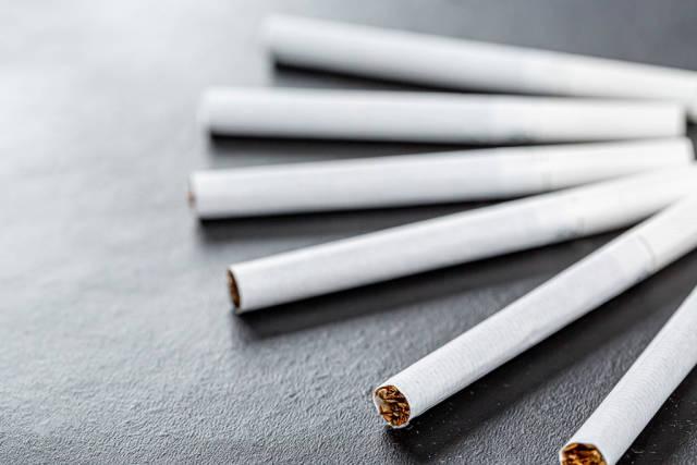 On a black background cigarettes closeup