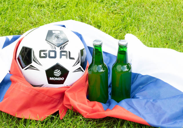 Two beer bottles with soccer ball on Russian flag