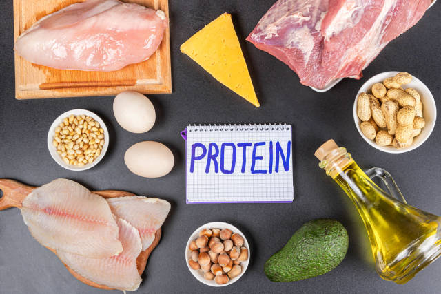 Protein diet products on a black background with an inscription in the center