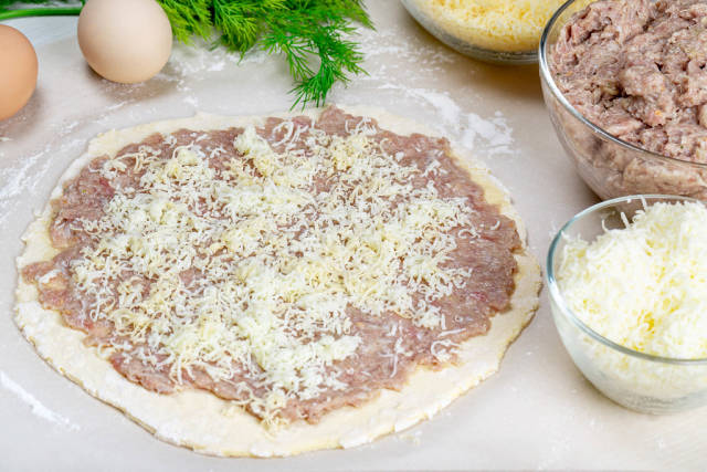 Raw dough with minced meat and cheese. Cooking concept