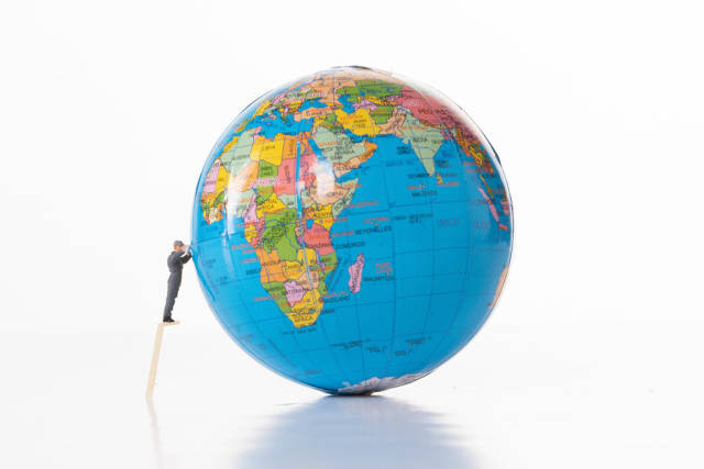 Man cleaning globe on white background