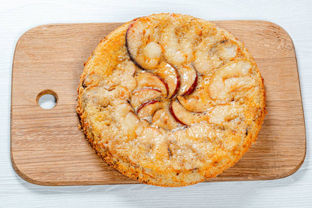 Charlotte apple pie on the kitchen board. View from above