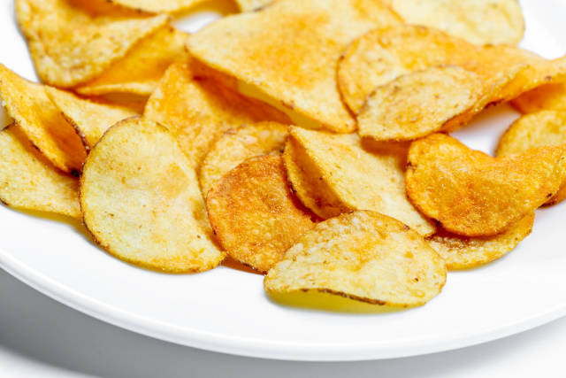 Potato chips on a white plate