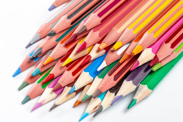 A bunch of colored pencils with sharp tips