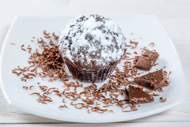 Cake with chocolate on a white plate