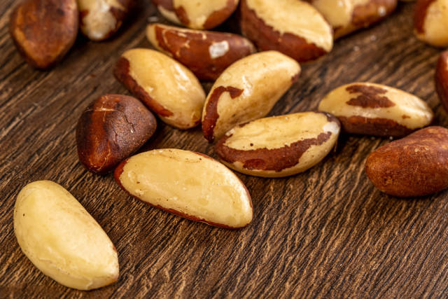 Brazil nuts on a wooden background
