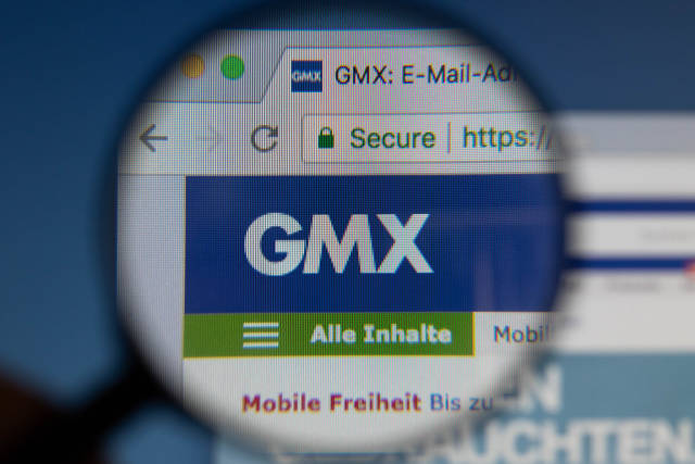 GMX logo on a computer screen with a magnifying glass