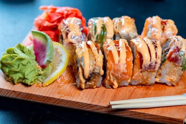 Sushi with chopsticks.