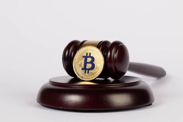 Golden Bitcoin with judge hammer