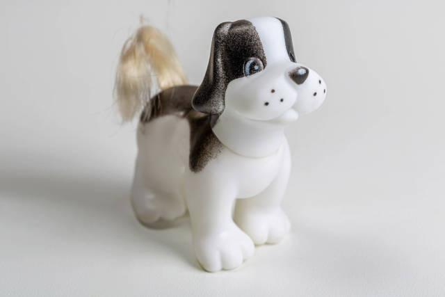 Toy figure of a dog on a white background
