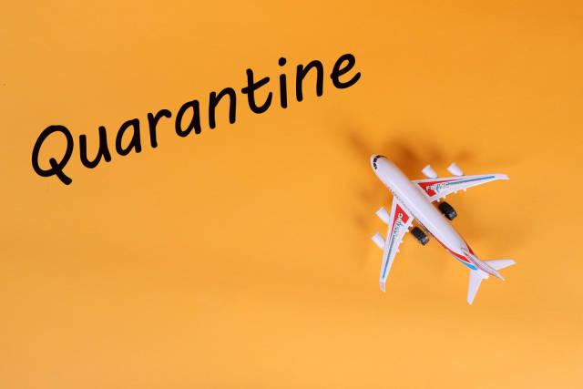 Airplane with Quarantine text on orange background