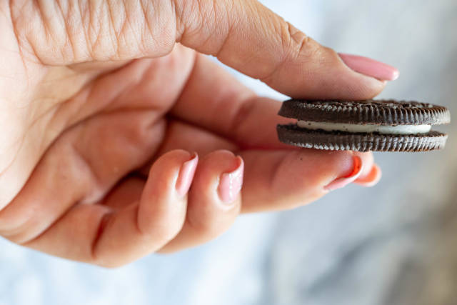 Brown cookies in a womans hand