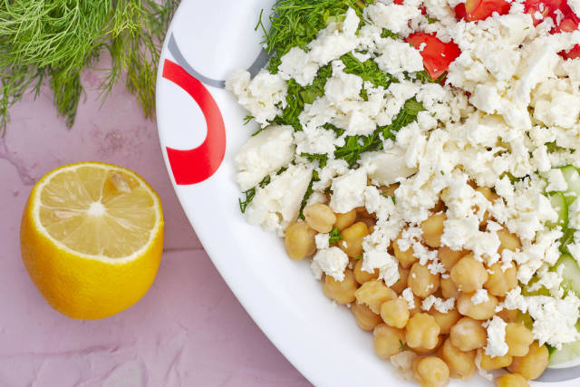 Close-up shot of delicious greek chickpea salad on plate