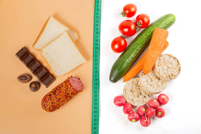 Healthy nutrition concept, vegetables vs sweets and unhealthy food
