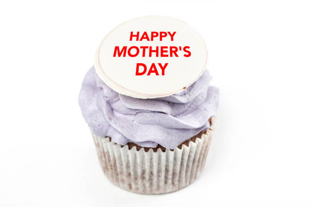 Cupcake with purple cream and happy mothers day inscription